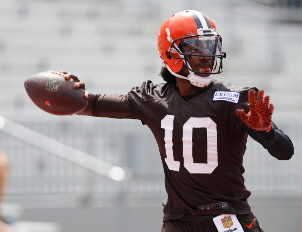 Cleveland Browns quarterback Robert Griffin III drops back to pass during their orange and brown scrimmage at the NFL football team's training camp Saturday, Aug. 6, 2016, in Columbus, Ohio. (AP Photo/Jay LaPrete)