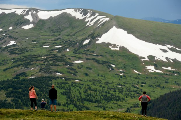 People hike in Rocky Mountain National Park just outside of Estes Park on July 14. The National Park Service is celebrating its centennial this year.
