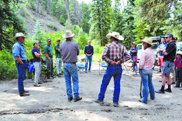 Sen. Michael Bennet listens to members of the Thompson Divide Coalition following a tour of the Thompson Divide, which Bennet hopes to protect from oil and gas exploration.