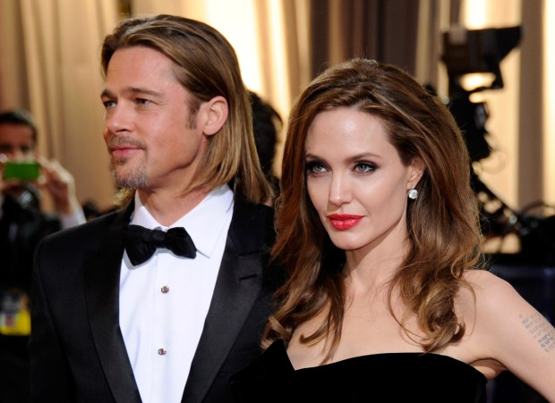 Actor Brad Pitt (L) and actress Angelina Jolie arrive at the 84th Annual Academy Awards at the Hollywood & Highland Center February 26, 2012 in Hollywood, California.