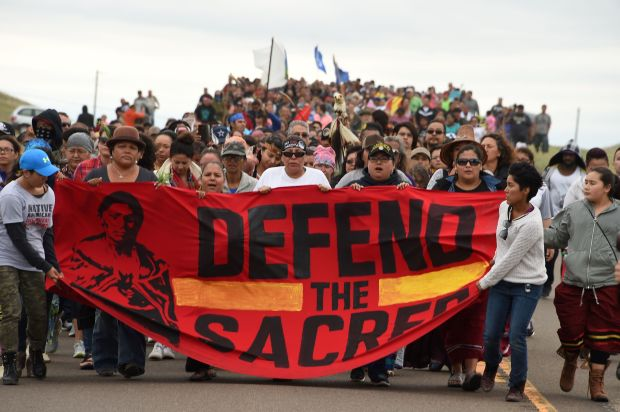 Native Americans march to the site of a sacred burial ground that was disturbed by bulldozers building the Dakota Access Pipeline