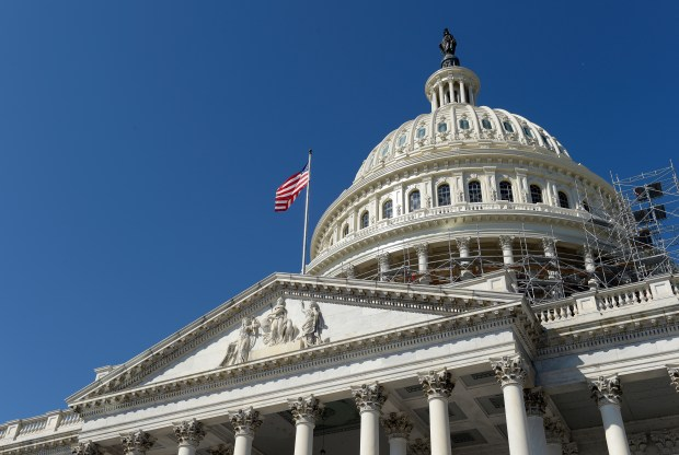 An American flag flies in front of the U.S. Capitol on Tuesday as lawmakers return from a seven-week break.