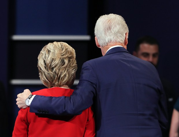 Former President Bill Clinton puts his arm around Democratic presidential nominee Hillary Clinton after her debate against Donald Trump on Monday.