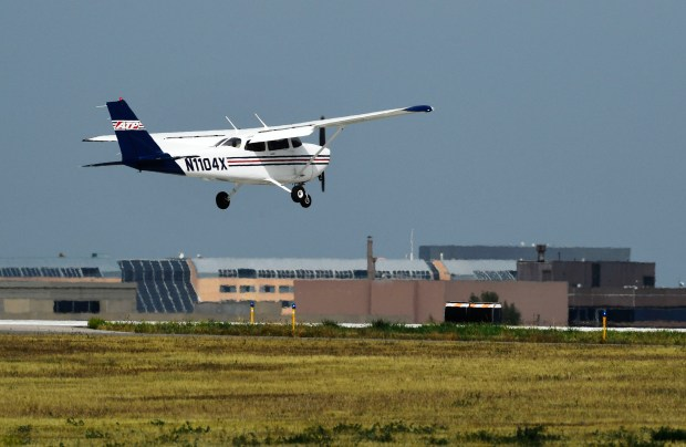 An aircraft comes in for landing at the Centennial Airport September 22, 2016.