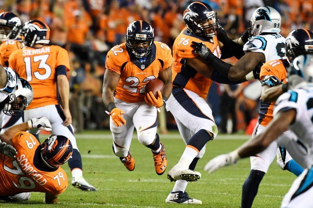 Broncos running back C.J. Anderson (22) runs against the Carolina Panthers