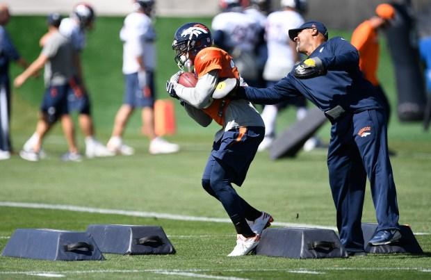 Devontae Booker runs through practice