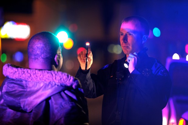 An Aurora police officer conducts a field sobriety test on a man suspected of drunken driving on Nov. 2, 2012.
