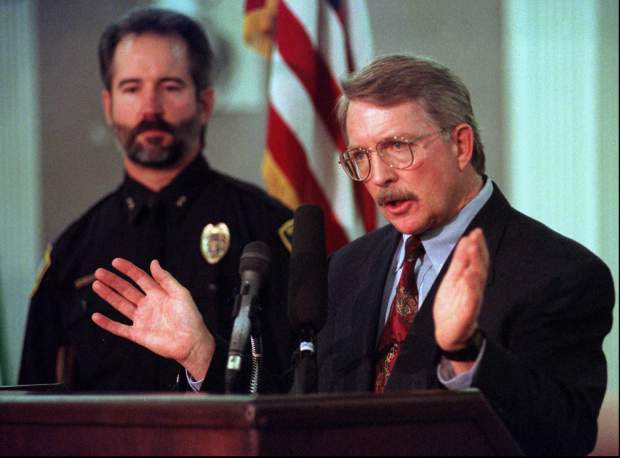 District Attorney Alex Hunter, right, answers questions, Feb. 13, 1997, about the murder of 6-year-old JonBenet Ramsey during a news conference with Boulder Police chief Tom Koby in Boulder, Colo.