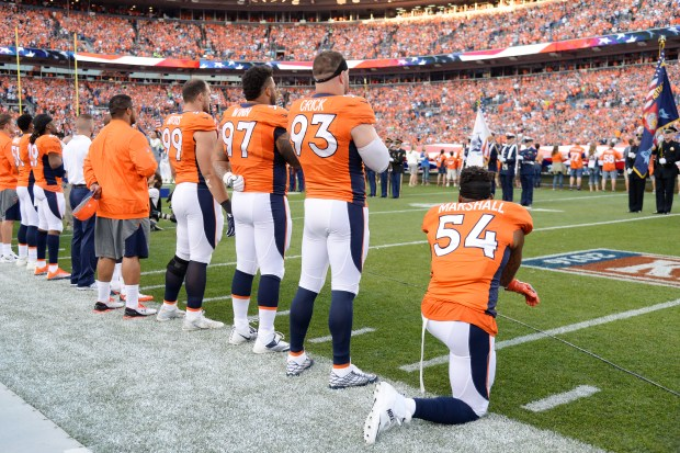 Brandon Marshall kneels during the National Anthem in a game against the Panthers.