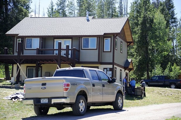 Routt County Sheriff's Office officials investigate at a home in the Stagecoach area where a Steamboat Springs police officer's 3-year-old son was killed after a gun accidentally went off.