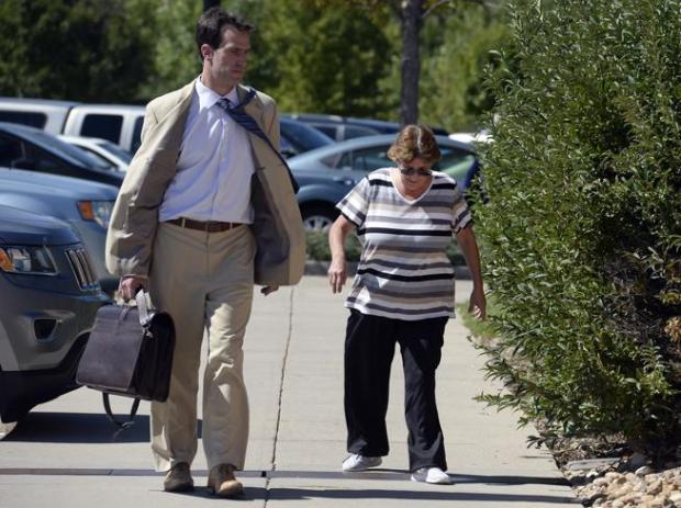 Vanessa Hall enters the Boulder County Jail with her attorney, Benjamin Collett, on Monday.