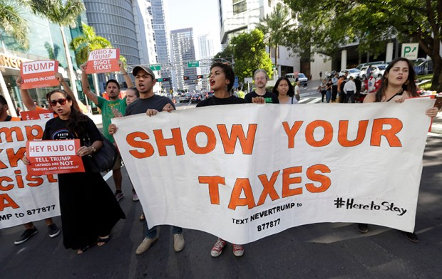 Protesters march in Miami on Sept. 16, urging Republican presidential nominee Donald Trump to release his tax returns.