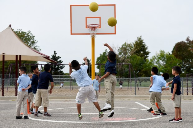 Students shoot basketballs while playing a game during recess at Maxwell Elementary School in Denver, Colorado on September 20, 2016. PlayWorks is a nonprofit organization that promotes recess and play as ways to teach young kids. (Photo by Seth McConnell/The Denver Post)
