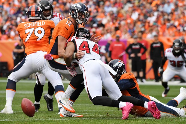 Vic Beasley (44) of the Atlanta Falcons strips Paxton Lynch during the third quarter. The Denver Broncos hosted the Atlanta Falcons on Sunday, October 9, 2016.