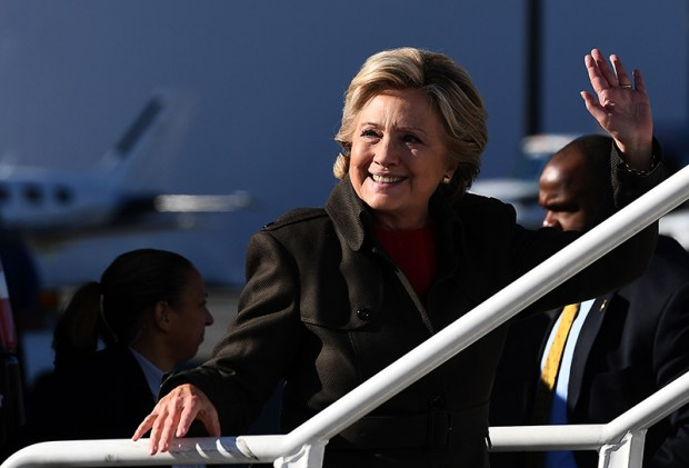 Democratic presidential nominee Hillary Clinton waves as she boards her campaign plane in White Plains, N.Y., on Monday. Clinton's campaign was jolted when FBI director James Comey announced last Friday that his agents are reviewing a newly discovered trove of e-mails, resurrecting an issue Clinton had hoped was behind her.
