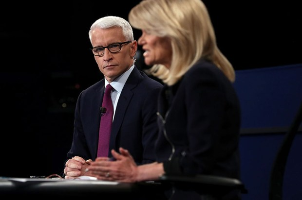 Anderson Cooper looks on as fellow moderator Martha Raddatz speaks during the Sunday night's presidential debate in St. Louis.