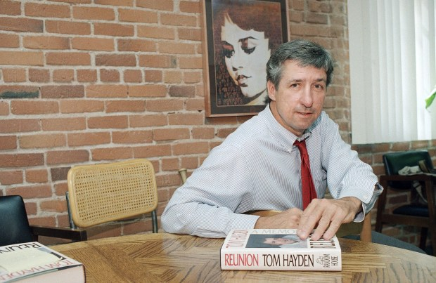 "In this June 6, 1988 file photo, Tom Hayden talks about his new book, ""Reunion,"" during a interview at his office in Santa Monica, Calif."