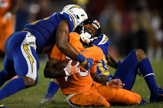John Leyba, The Denver Post Denver Broncos wide receiver Emmanuel Sanders #10 takes a hard hit and is rocked in the 4th quarter against the San Diego Chargers at Qualcomm Stadium, San Diego, CA October 13, 2016. Joe Amon, The Denver Post