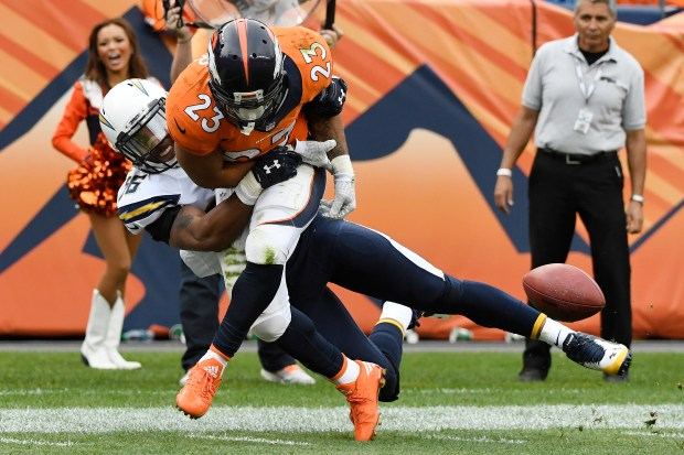 Korey Toomer (56) of the San Diego Chargers forces a fumble on Devontae Booker (23) of the Denver Broncos