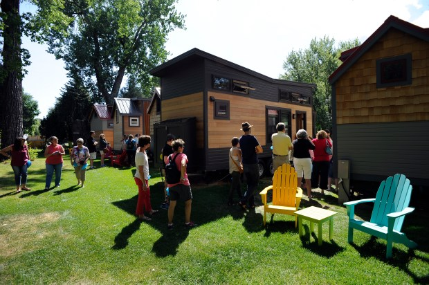 People line up in front of the tiny hotels for their turn to get a view inside of the buildings. WeeCasa Tiny Home Hotel hosts a tiny home tour in Lyons on Saturday, August 27, 2016.