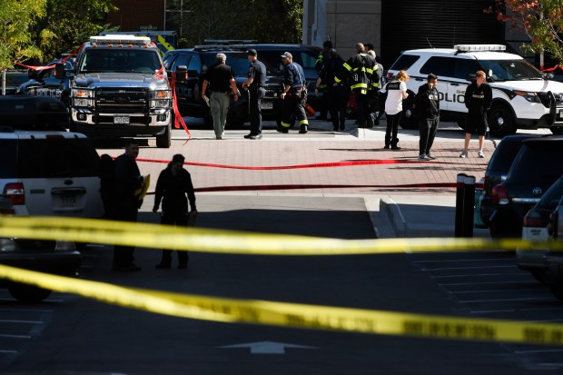 Emergency personnel and police work the scene of an officer involved shooting near the Champions Center on the University of Colorado Boulder campus on October 5, 2016 in Boulder.