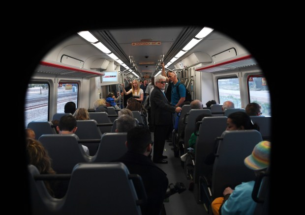 Riders travel Denver International Airport on the new University of Colorado A Line train, April 22, 2016. The line is 23 miles with 8 stations along the way.