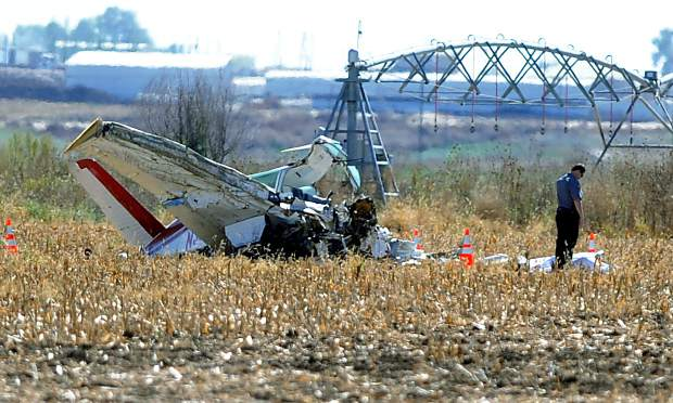 Emergency responders sift through the wreckage of a plane in October 2015 east of Ault after it crashed, killing two people aboard.