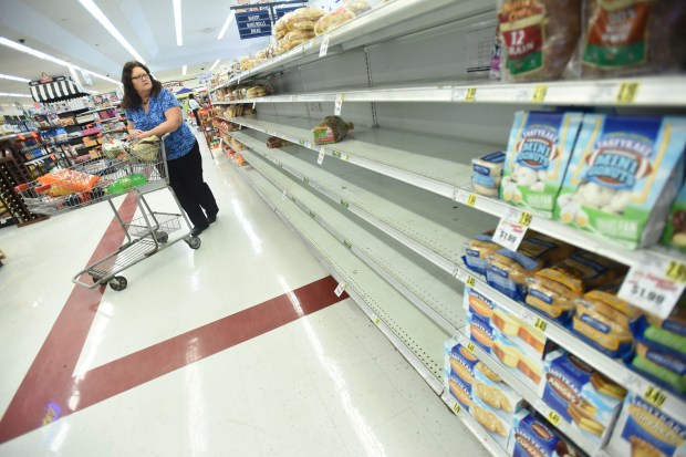 Mary Stanley looks over the bread isle at the Piggly Wiggly, Wednesday, Oct. 5, 2016 in Leland, N.C. Some stores like Piggly Wiggly and the Walmart are running low on bread as Hurricane Matthew comes up the east coast. Ken Blevins, The Star-News via The Associated Press