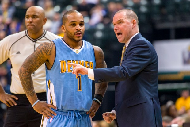 Denver Nuggets head coach Michael Malone, right, talks with guard Jameer Nelson (1)