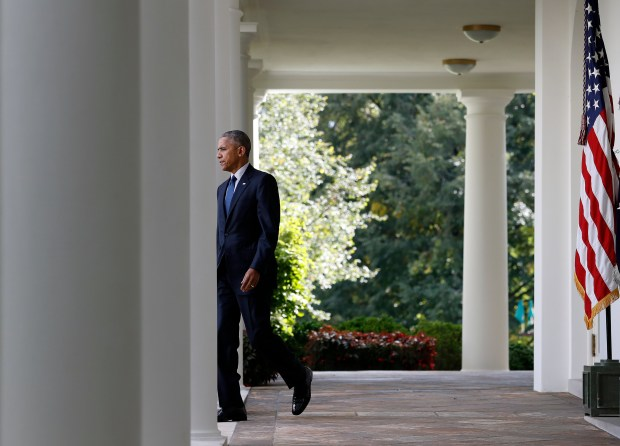 President Obama walks from the Oval Office to speak in the Rose Garden at the White House on Wednesday.