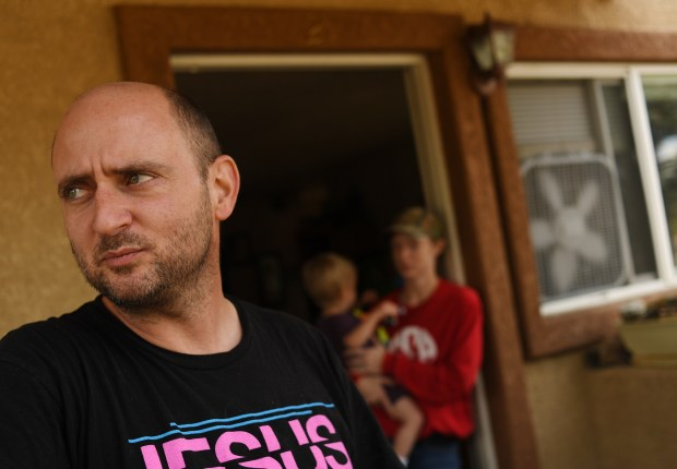 Phillip Alleman, left, stand outside his apartment in Fountain, October 25, 2016. Alleman, with his wife Shauna and their son P.J., is upset with the lack of coverage, form the media on the story of the PFCs in the city's drinking water. (Photo by RJ Sangosti/The Denver Post)