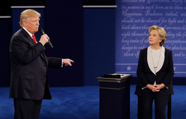 Republican presidential nominee Donald Trump answers Democratic presidential nominee Hillary Clinton during the second presidential debate at Washington University in St. Louis, Sunday, Oct. 9, 2016.
