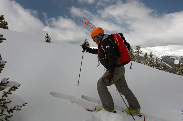 Scott Toepfer, right, makes his way towards the debris field and site of the avalanche at Sheep Creek near Loveland Pass on Sunday, April 21, 2013. He and two other members of the Colorado Avalanche Information Center carefully deconstructed the area of the deadly avalanche that killed 5 snowboarders on the day before. The trio did what is called a fracture line profile at the crown of the avalanche, or where the hard slab avalanche broke off.