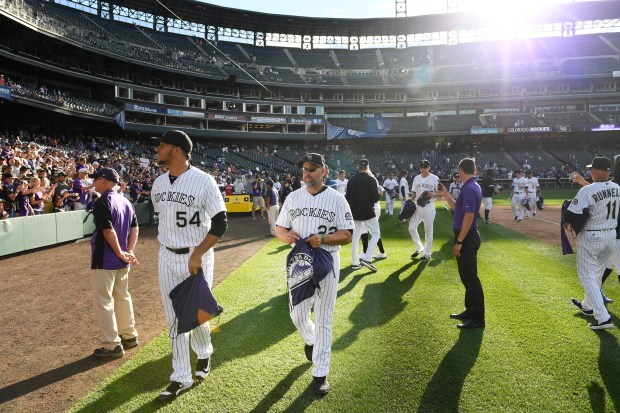 Colorado Rockies head coach Walt Weiss , middle, gets ready to meet with fans