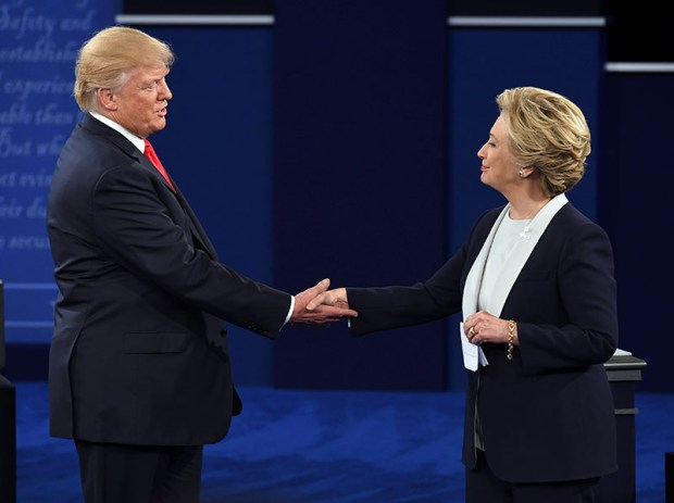 Donald Trump and Hillary Clinton shake hands at the end of Sunday night's presidential debate at Washington University in St. Louis.