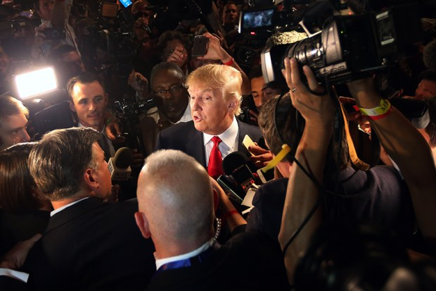 Donald Trump talks to reporters after an Aug. 6, 2015, Republican primary debate in Cleveland.