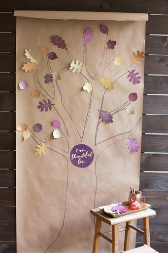 """A paper """"thankful tree"""" is a whimsical addition to Thanksgiving dinner decorating, says crafter Lia Griffith, but it's also a great way to keep kids busy during meal preparation and help them focus on the real meaning of the holiday. Griffith offers downloadable leaf patterns and a printable sign for the center at her website."""