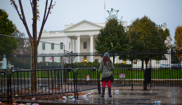 Carolyn Supinka, resident of Washington D.C., looks towards the White House in Washington, Nov. 9, 2016.