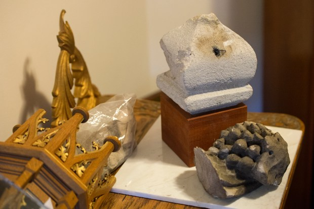 A piece of stone struck by lightning and a grape cluster that fell from the roof of the Basilica are photographed at the Cathedral Basilica of the Immaculate Conception in Denver