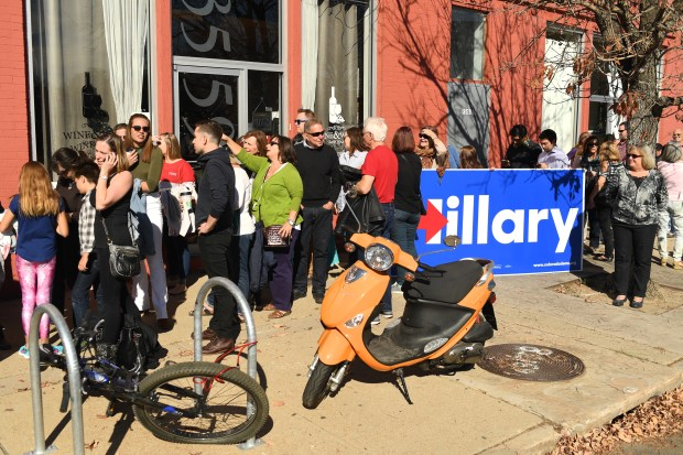 People line up to attends a rally for Hillary Clinton at Exdo Event Center in Denver.