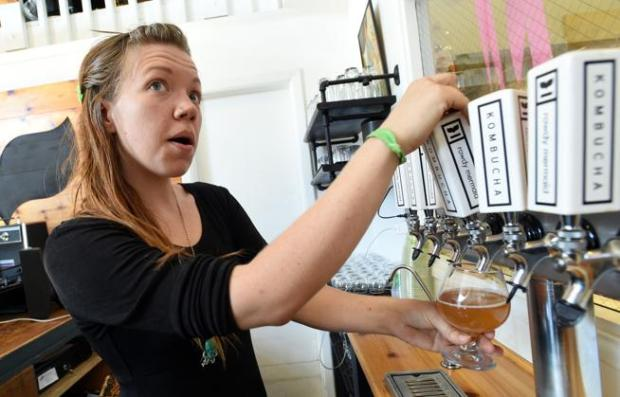 Nikita Anderson pours a glass of kombucha at the Rowdy Mermaid Kombucha company in Boulder on Nov. 2, 2016.