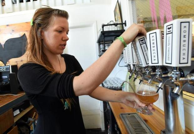 Nikita Anderson pours a glass of kombucha at the Rowdy Mermaid in Boulder on Nov. 2.