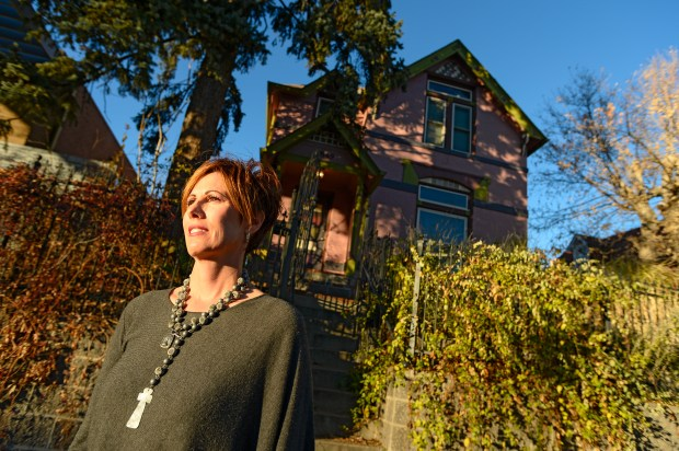 Judith Battista in front of her property on Nov. 15, 2016, on West 23rd Avenue. The latest battle to pit historic preservationists against potential development in booming Jefferson Park involves a city councilman's bid to preserve one of the last standing Victorian-era homes in the gentrifying neighborhood, against Battista's wishes.