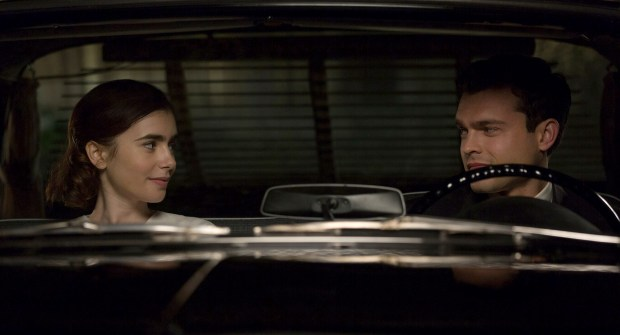 "Marla Mabrey (Lily Collins) finds herself attracted to her personal driver Frank Forbes (Alden Ehrenreich) in ""Rules Don't Apply."""