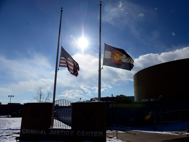 Flags fly at half-staff outside of the El Paso County Criminal Justice Center on Nov. 30, 2015, for University of Colorado-Colorado Springs police Officer Garrett Swasey, who was one of three people killed in a shooting at a Planned Parenthood clinic in Colorado Springs.