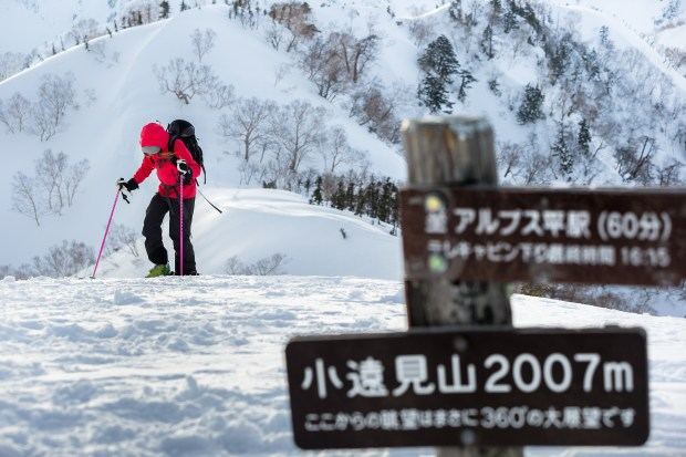 Sarah Frood transitions into downhill mode after a short hike up to the untracked slack country at Goyru Resort, Habuka, Japan.