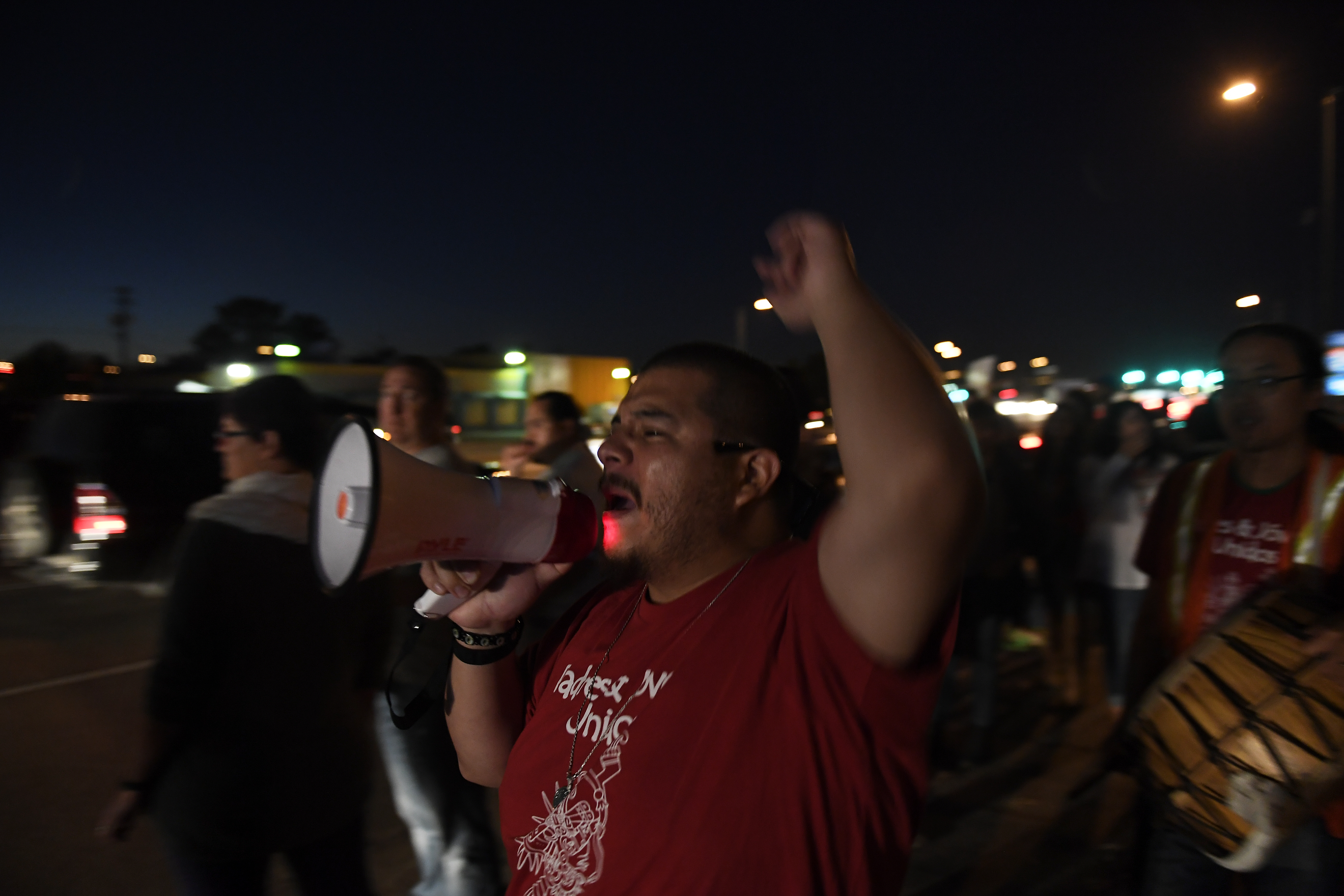 Juan Evangelista, youth organizer with Padres & J—venes Unidos leads chants at a Trump protest rally along Federal Blvd and 5th at East Barnum Park in Denver,CO November 09, 2016. Joe Amon, The Denver Post