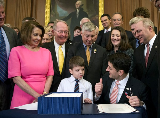 House Speaker Paul Ryan of Wis. gives a thumbs-up to 7-year-old Max Schill, who suffers from Noonan Syndrom, after signing the 21st Century Cures Act last Thursday in Washington. Watching, from left, are House Minority Leader Nancy Pelosi, Sen. Lamar Alexander, R-Tenn., Rep. Fred Upton, R-Mich., Rep. Diana DeGette, D-Colo., and House Majority Whip Steve Scalise.