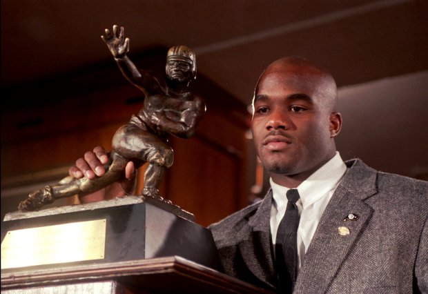 Colorado's Rashaan Salaam poses with the 1994 Heisman Trophy on Dec. 10, 1994, at the Downtown Athletic Club in New York.