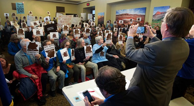 Supporters of Utah's Bears Ears national monument hold signs during a news conference Monday on Dec. 19 at the Utah State Capitol in Salt Lake City. President Obama on Wednesday officially declared the area a national monument.